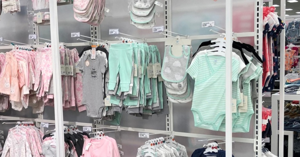 large hanging rack of baby clothes in store at target