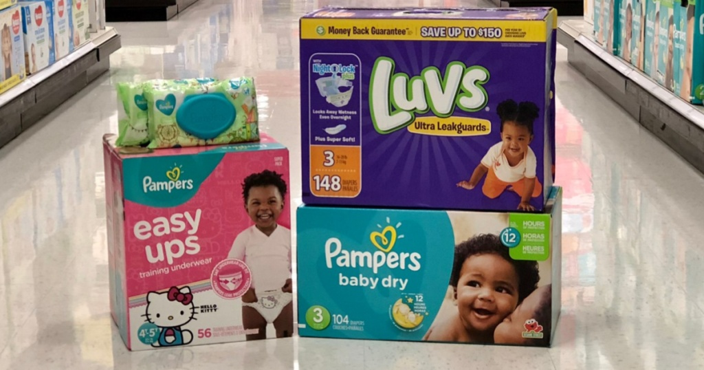 boxes of diapers and training underwear, and baby wipes on floor in store
