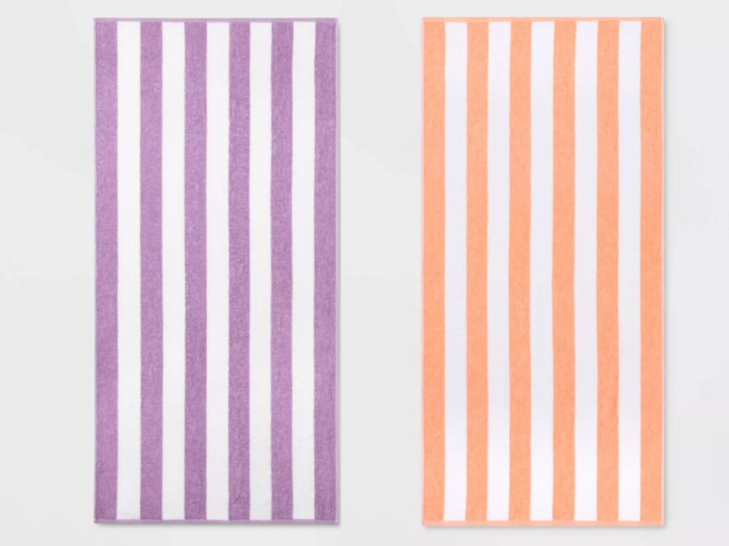 2 striped beach towels sitting next to each other