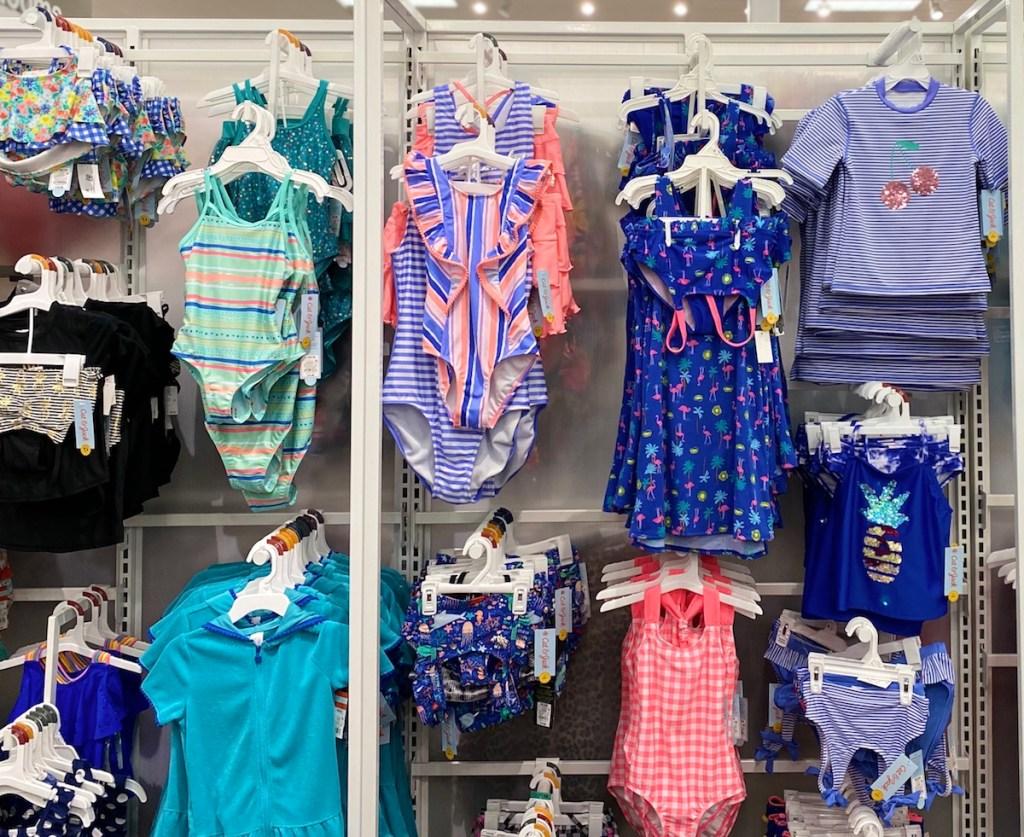 display of girl's swimwear at Target
