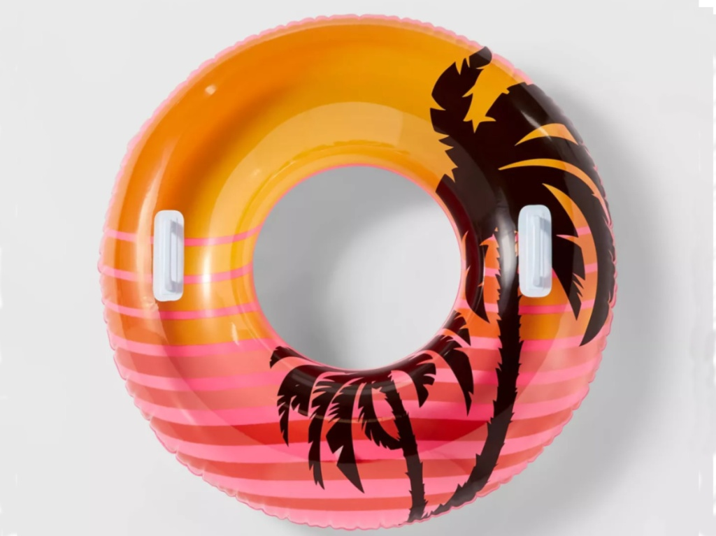 large round pool float with orange tropical design