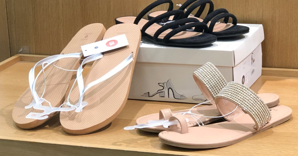 three pairs of women's sandals on shelf at target with shoe box propping up one pair