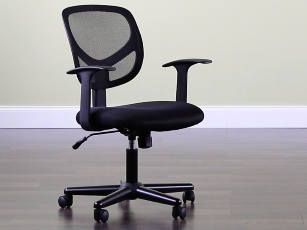 black mesh office chair sitting in an open room