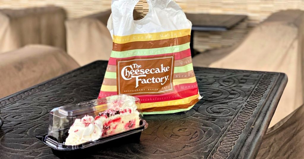 The Cheesecake Factory togo bag with cheesecake in take out container