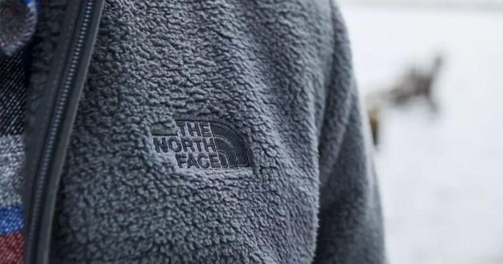 Close up view of the north face fleece logo