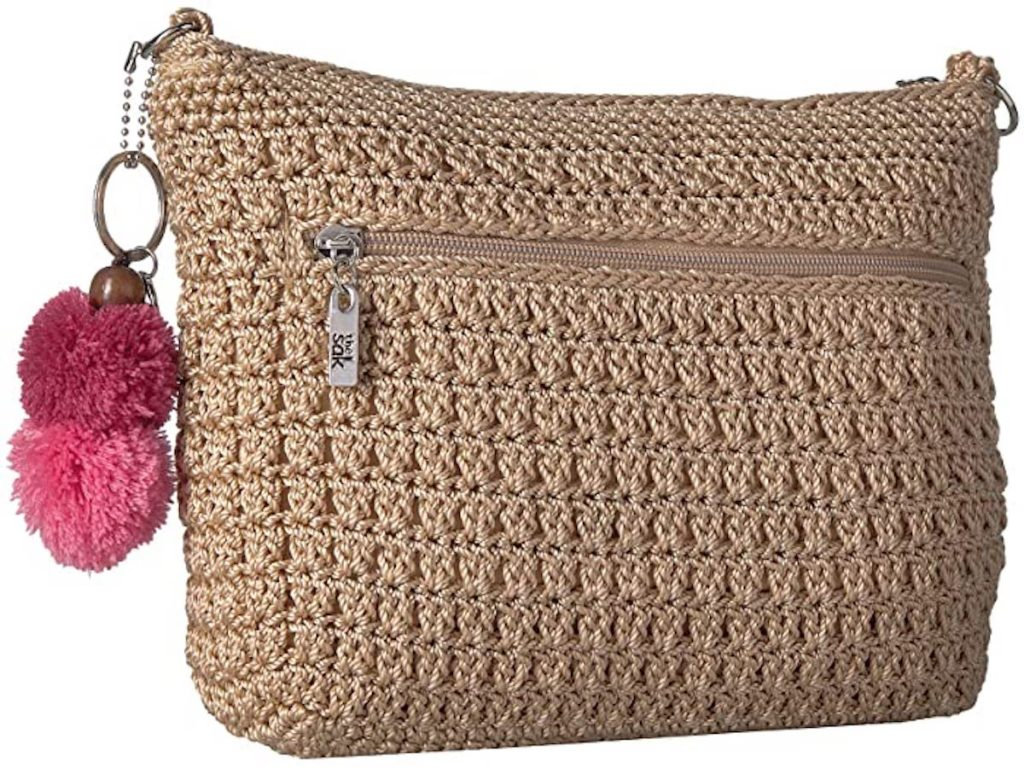 tan colored the sak Greenwood 3-in-1 Demi Crossbody Bag with pink pom poms