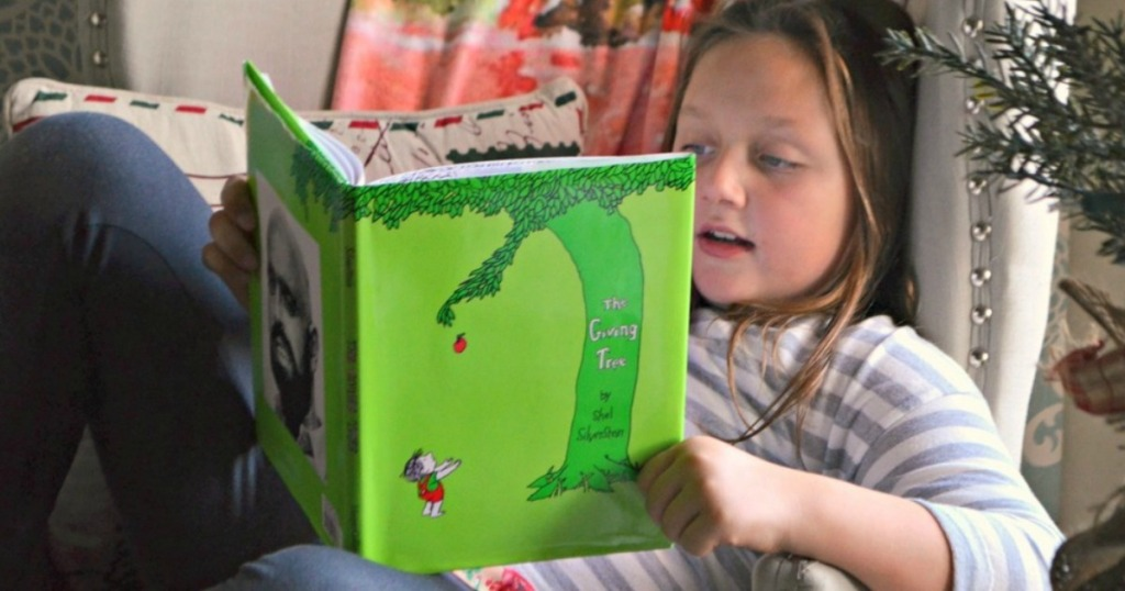 girl with The giving tree book