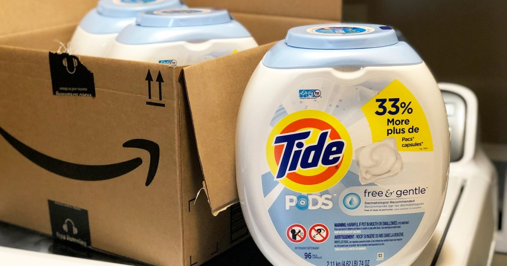 white container or tide pods free & clear detergent next to bow amazon shipping box