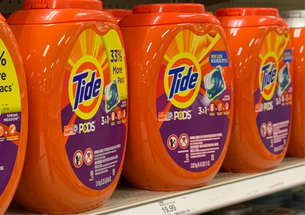 three tubs of laundry detergent pacs on store shelf