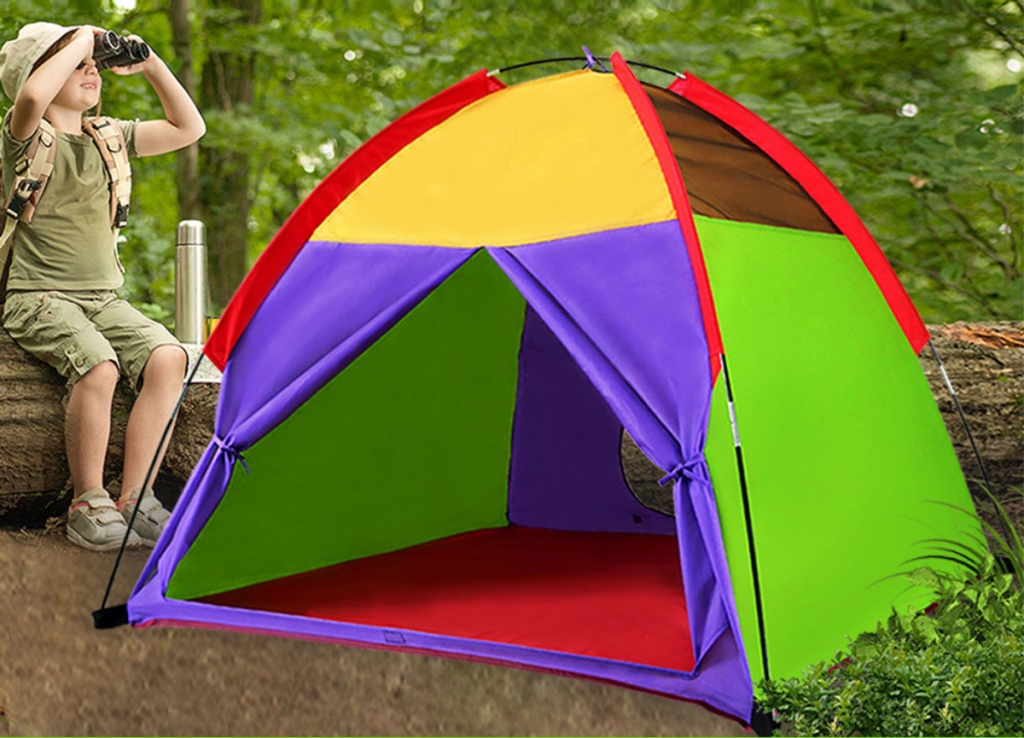 child using binoculars outside next to colorful tent