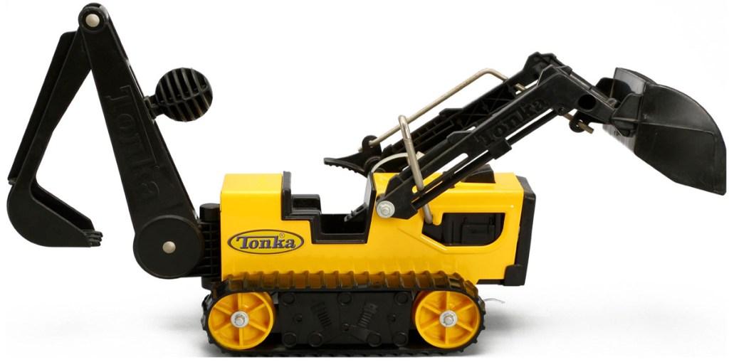 yellow nad black tonka trencher truck toy