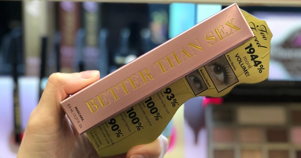 hand holding mascara in box in makeup store