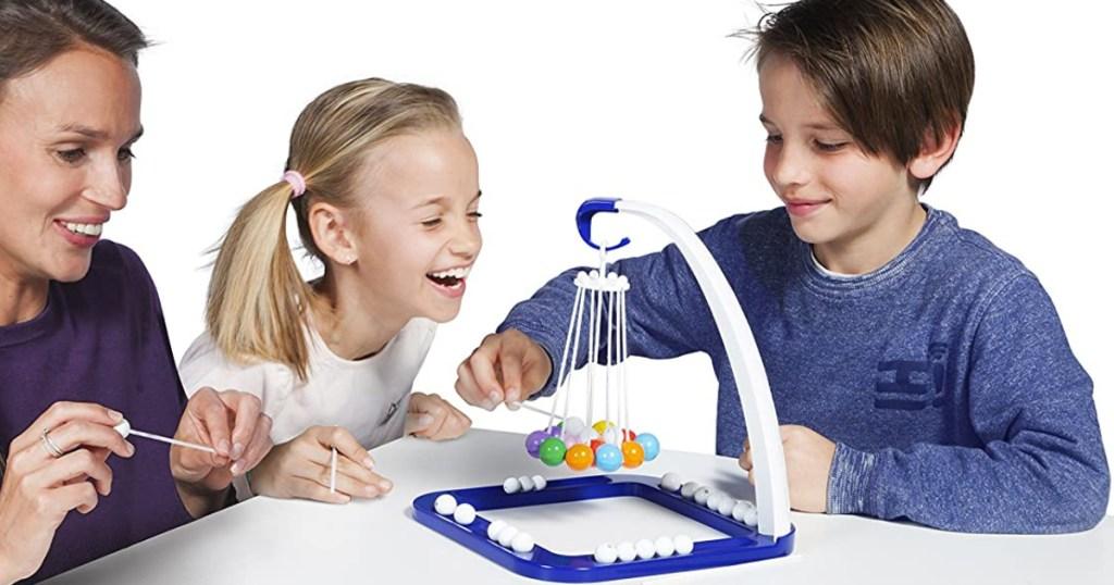 woman girl and boy playing tumball game