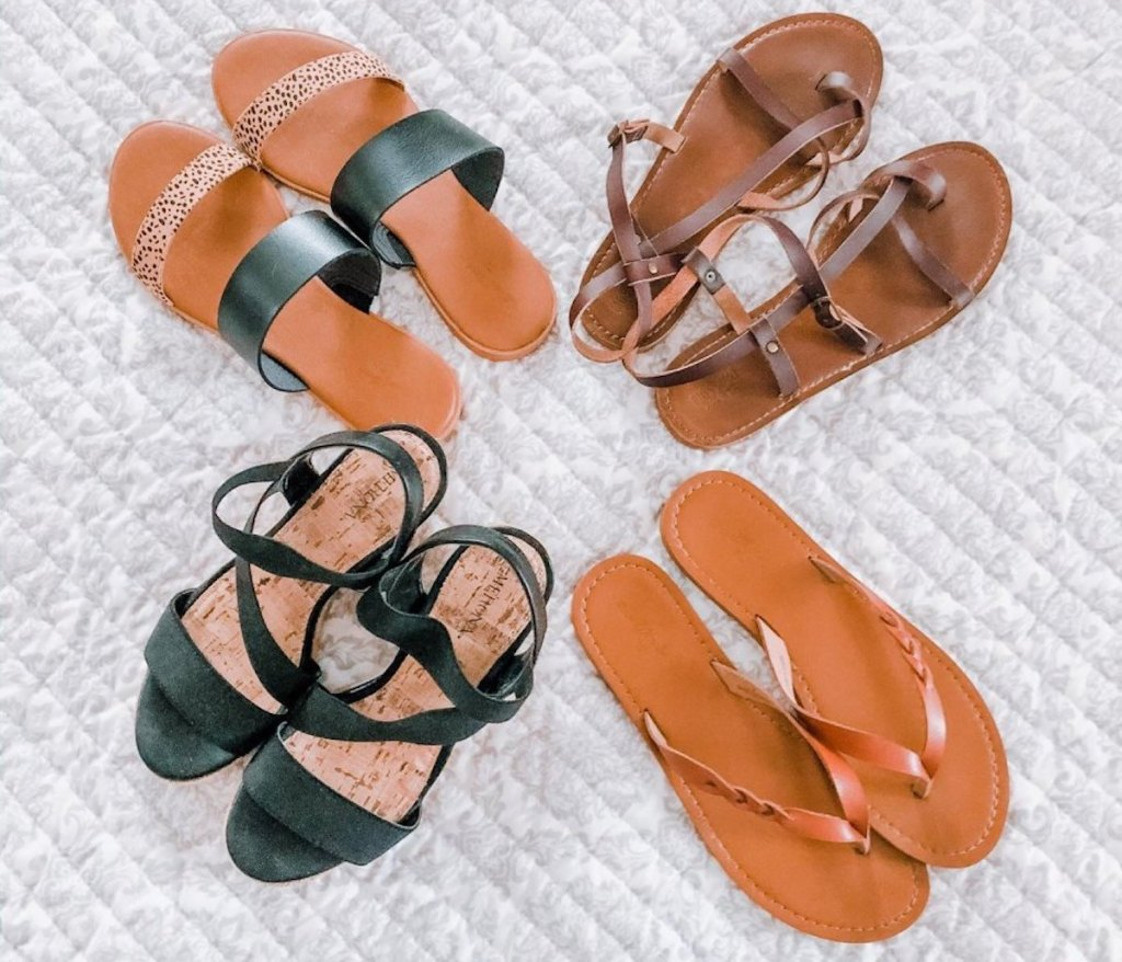 four pairs of target universal thread sandals in brown, black, dark down, and leopard