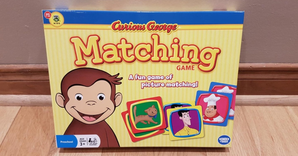 curious george memory game on table