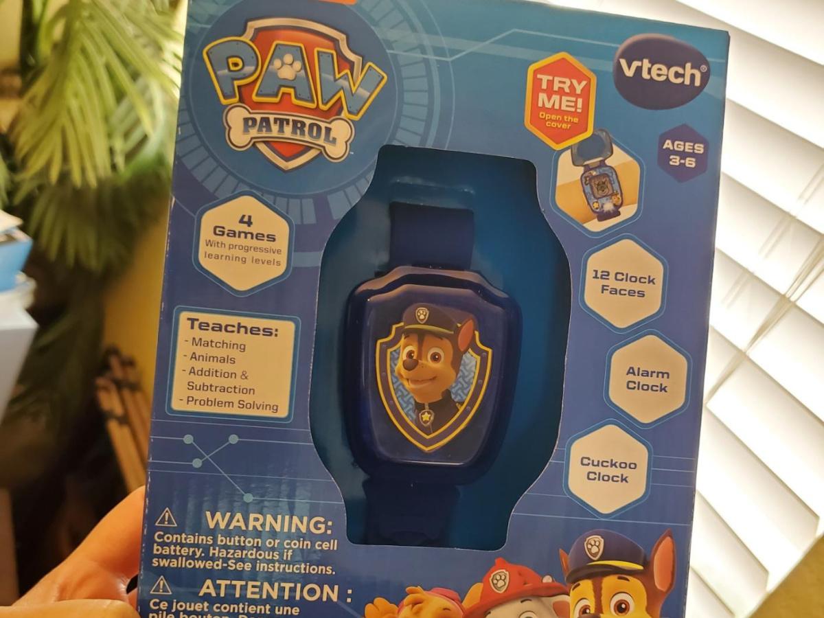 hand holding paw patrol watch box