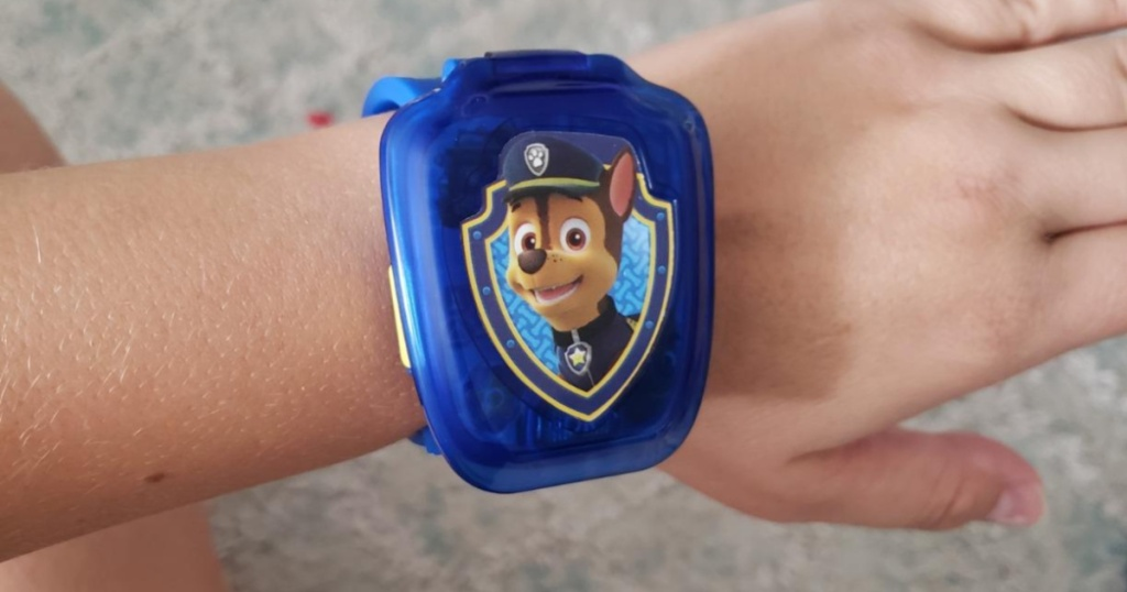 childs arm wearing blue chase paw patrol watch