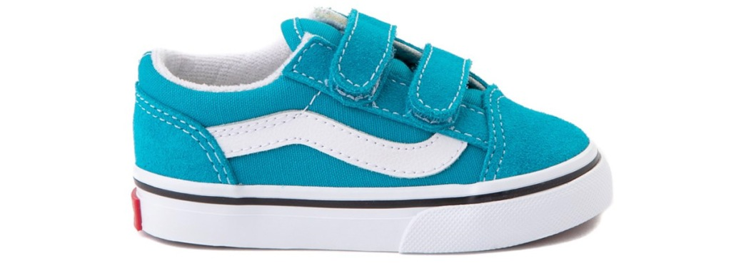 blue velcro sneakers with white vans logo along side