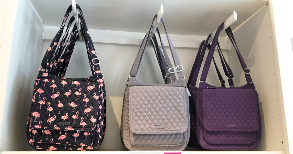 three quilted crossbody bags hanging on display in store