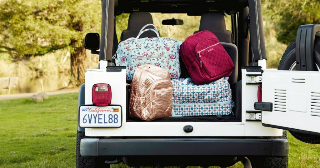 bags and backpacks in the back of a jeep