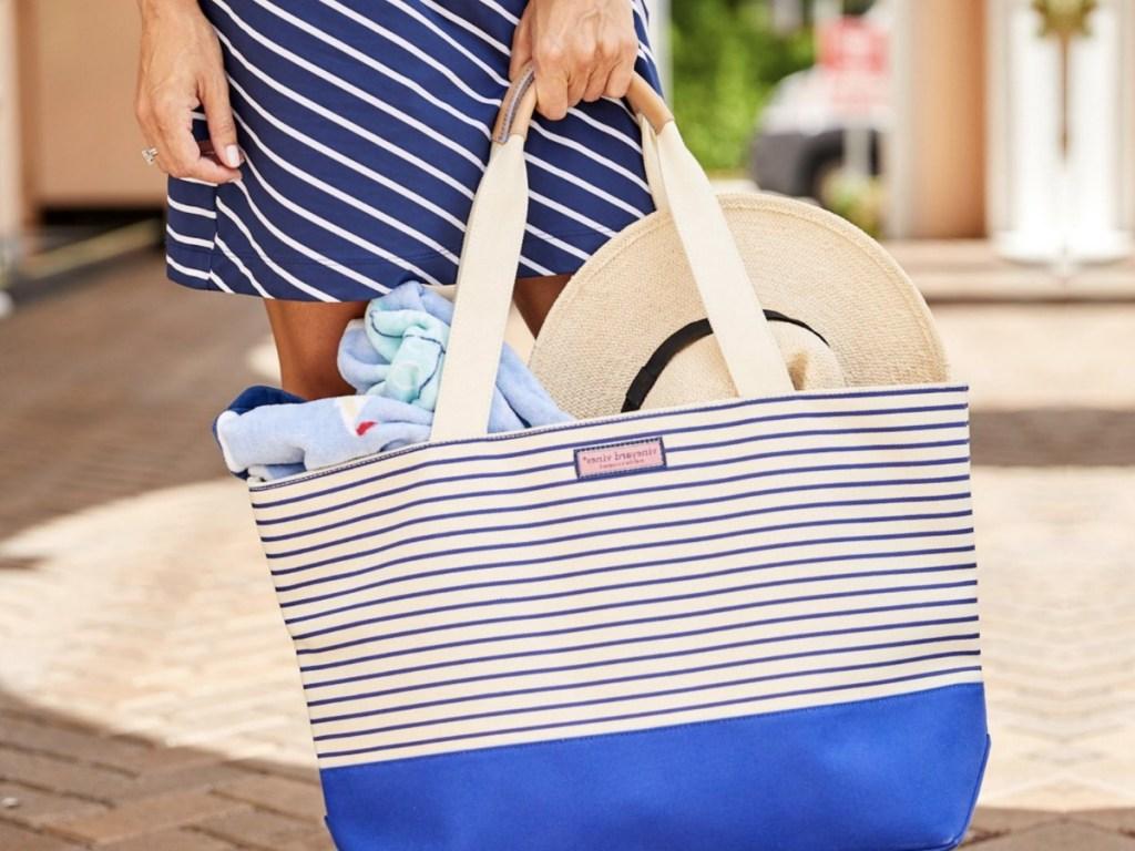 Woman holding Vineyard Vines Beach Bag