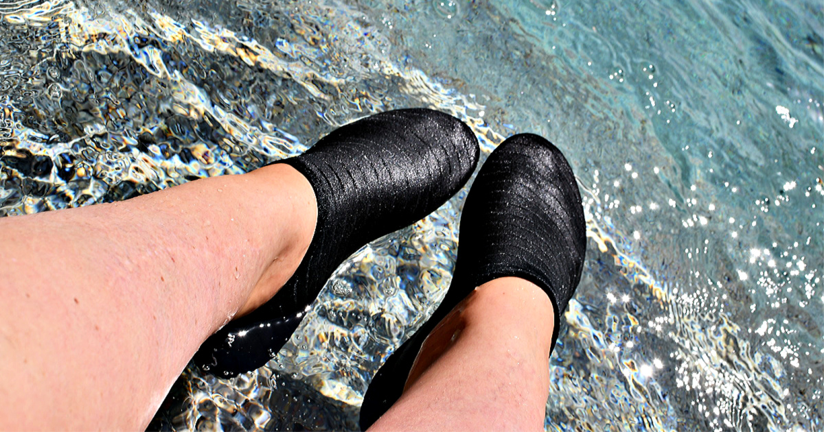 Water shoes on person's feet in water