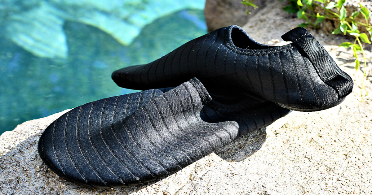 Water shoes on rock near water