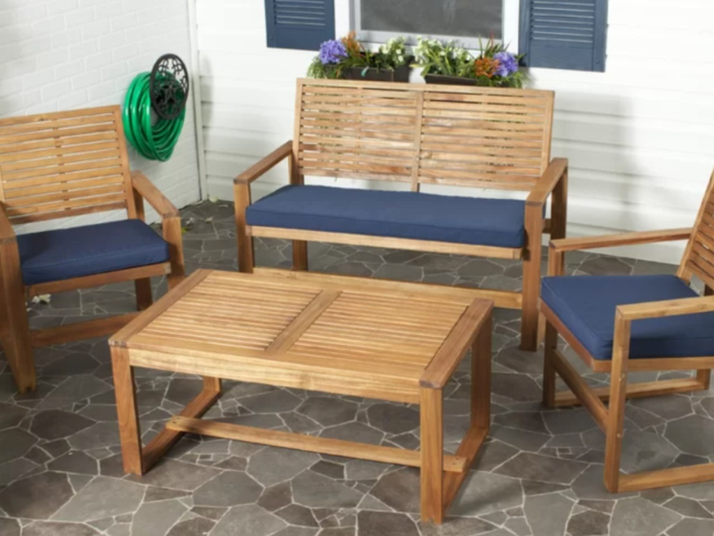 wooden outdoor patio set with blue cushions