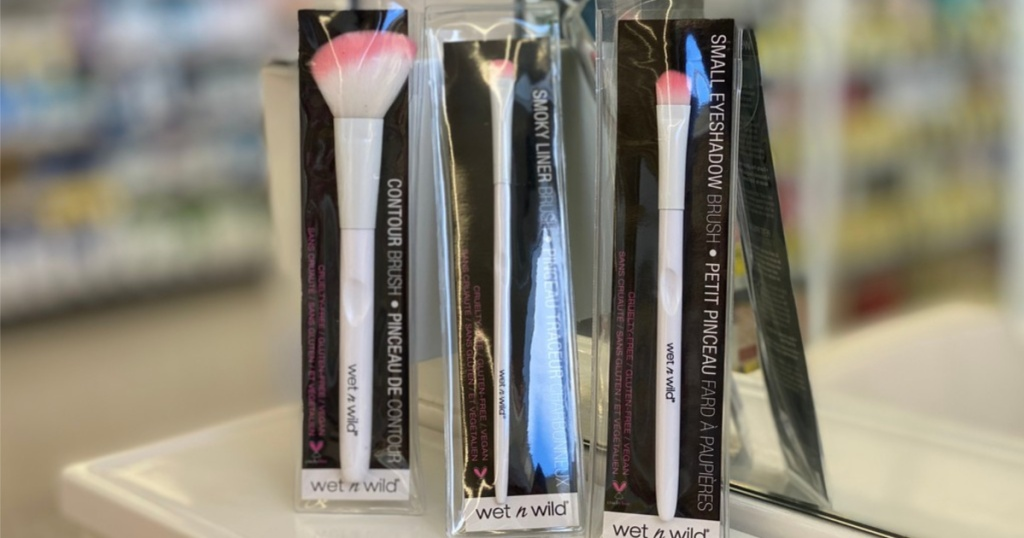 three white and pink makeup brushes in packaging in store