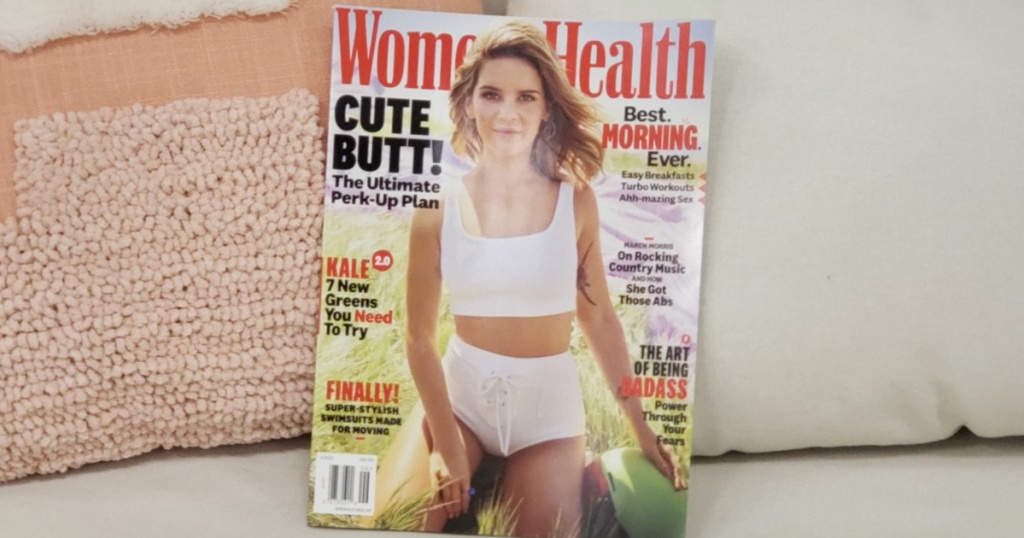 Women's Health Magazine propped up by pillows on a couch