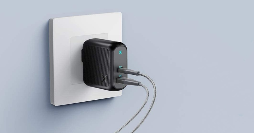 Xcentz USB-C Charger plugged into a wall with cords coming out