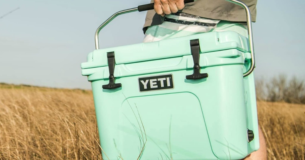 person carrying a YETI cooler