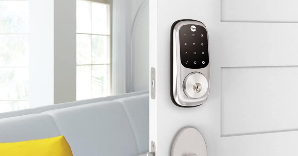 nickel Yale key lock on white door