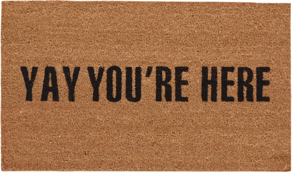 """tan doormat that says """"Yay You're Here"""" in black text"""