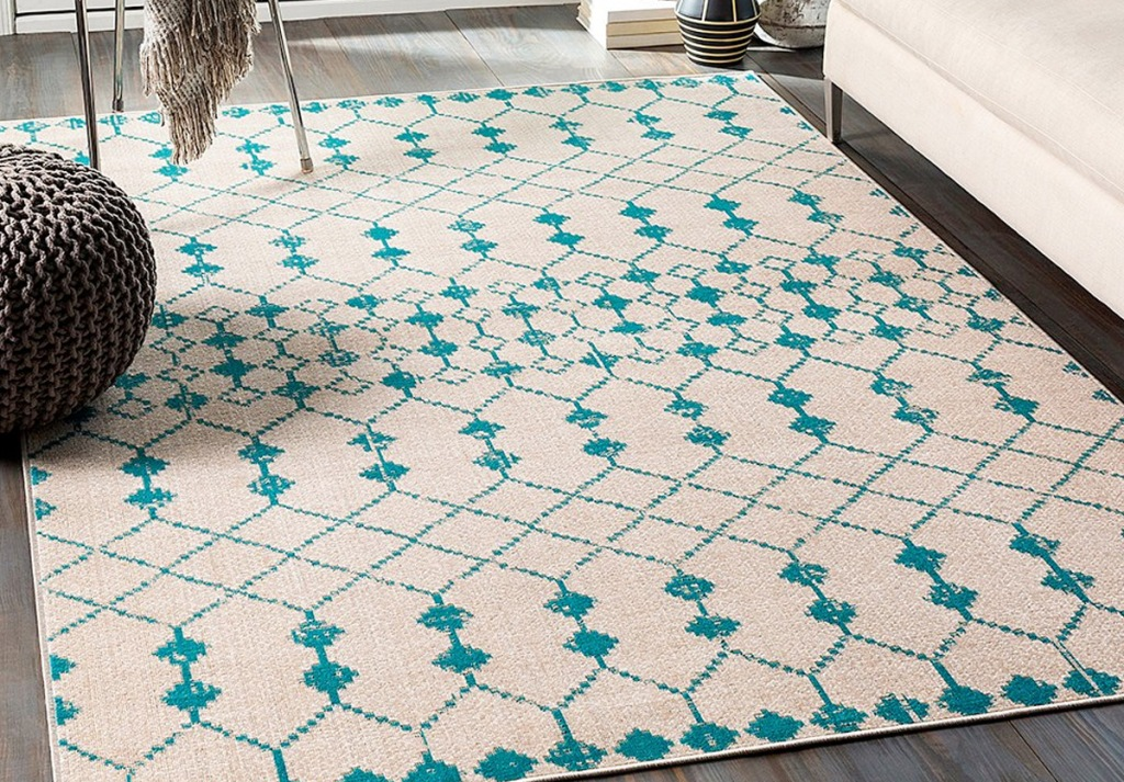 cream and teal abstract print area rug
