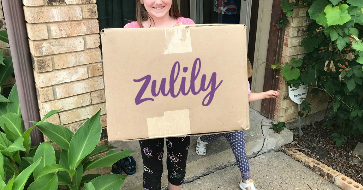 New zulily shipping box in hands of young girl
