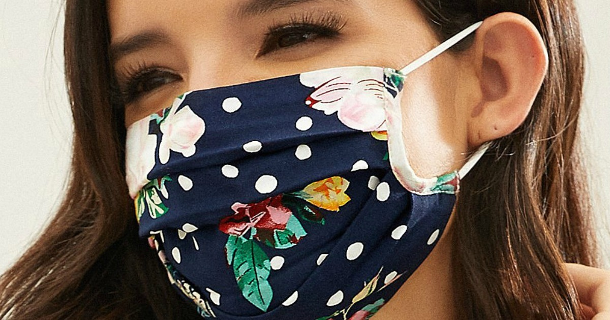 Woman wearing floral and polka dot face mask