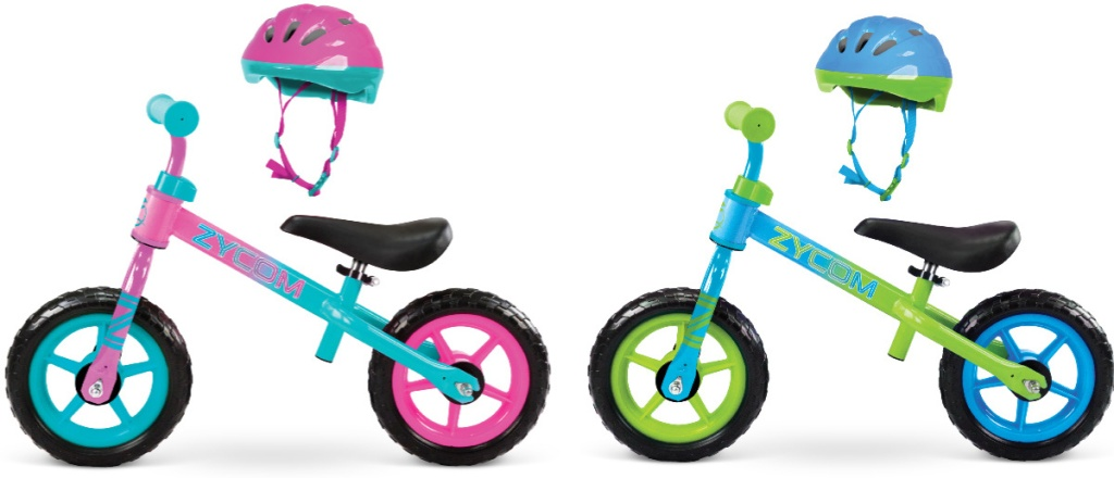 2 zycom toddler balance bikes next to each other with helmets