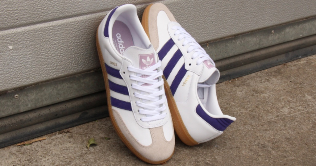 white, tan, and purple shoes leaned against wall outside