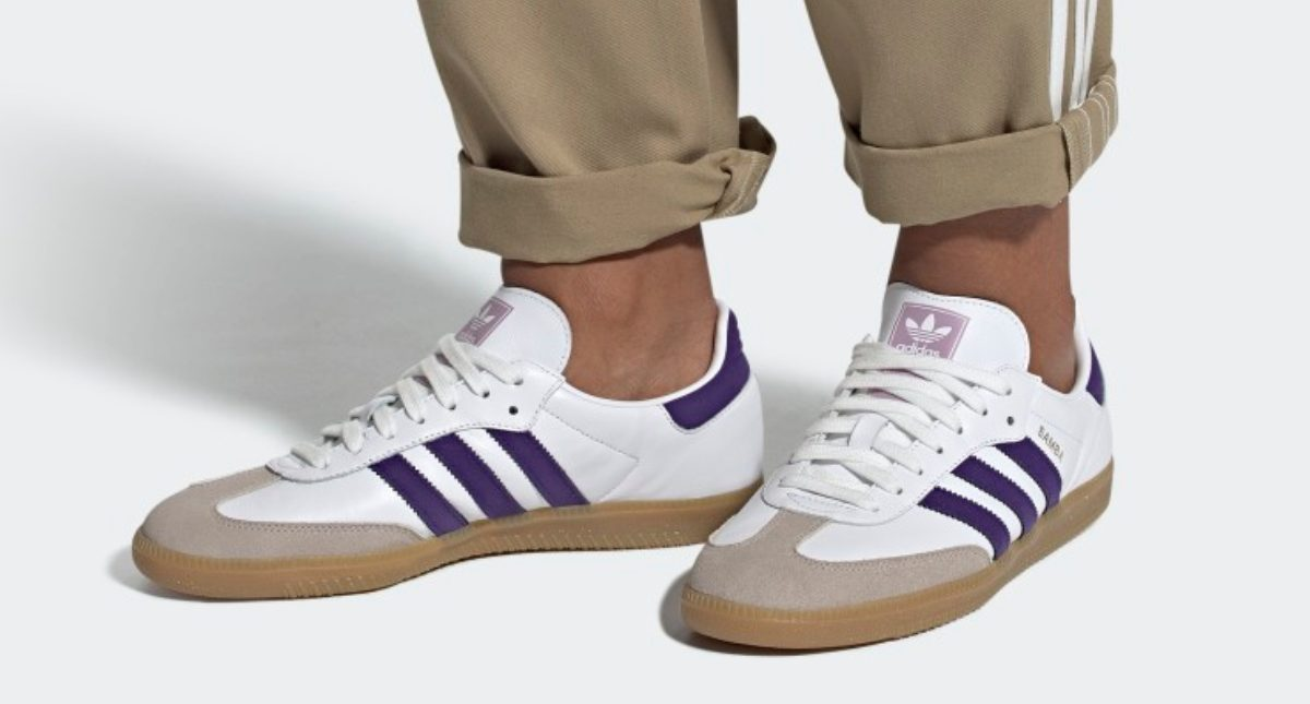 man in white, tan, and purple shoes