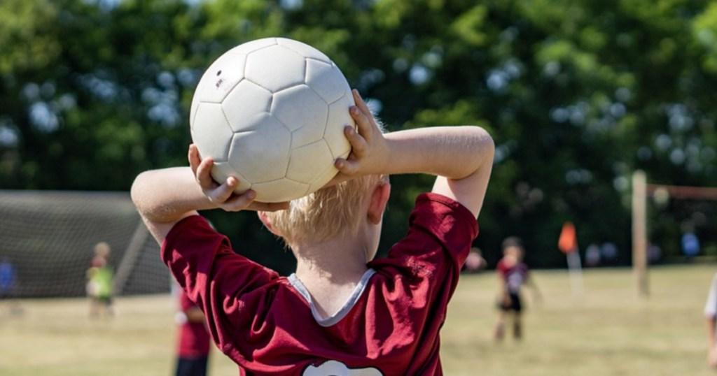 adidas soccer ball boy playing soccer