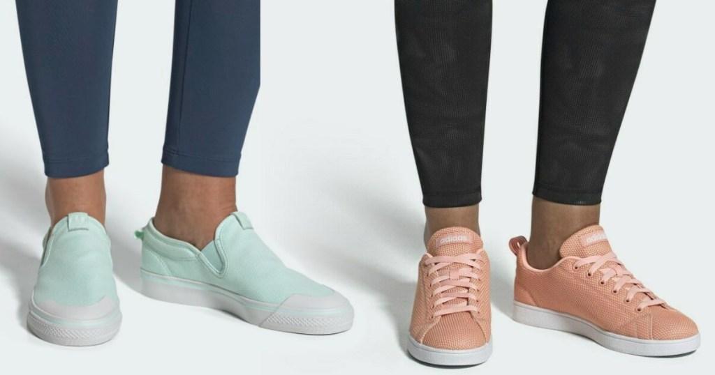 two women wearing adidas sneakers