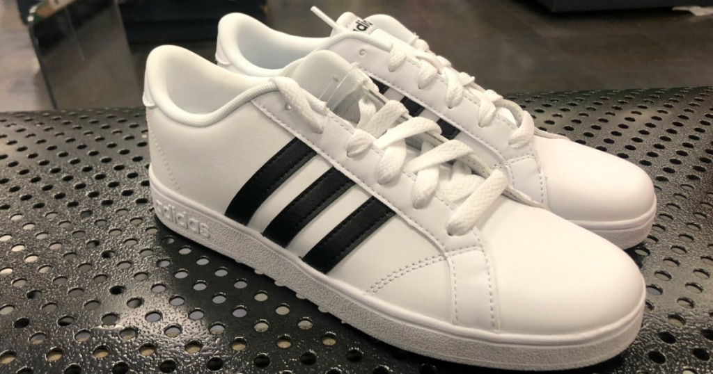 pair of black and white adidas shoes