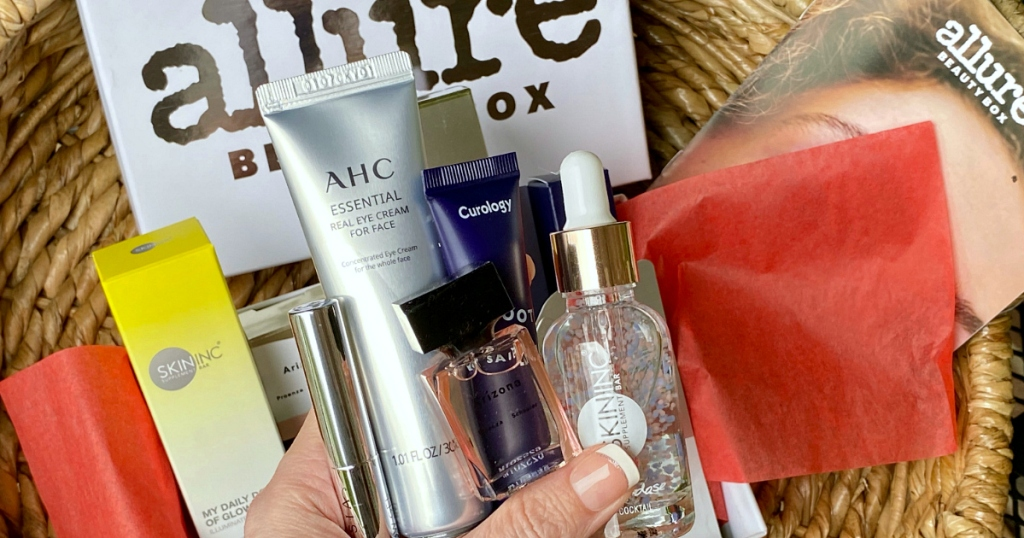 hand holding beauty supplies from Allure Beauty Box