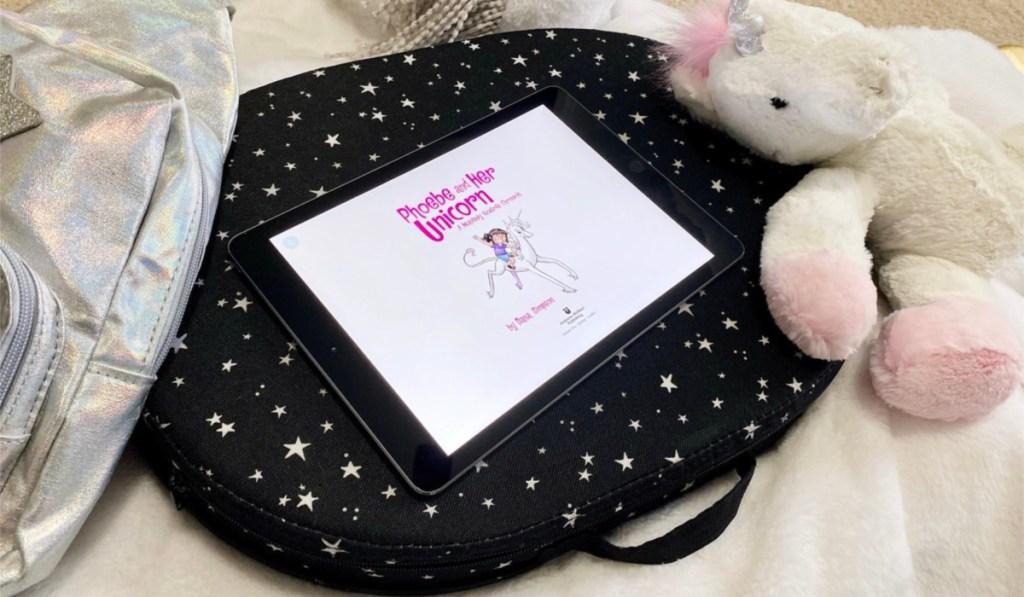 amazon freetime reading on ipad on bed next to unicorn