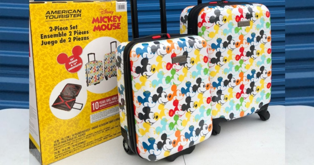 american tourister mickey mouse luggage set in front of blue door