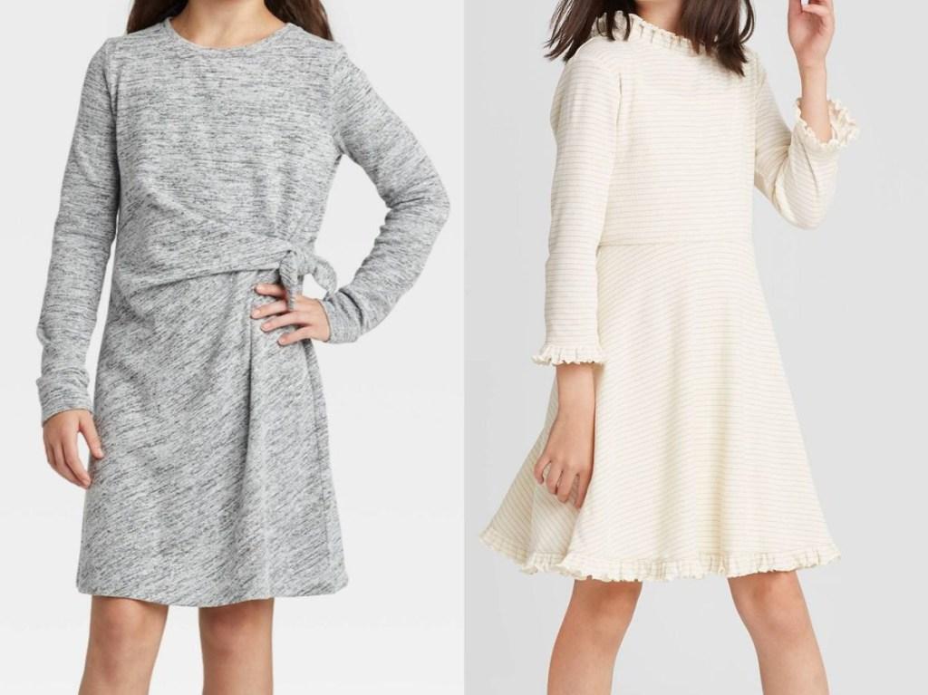 girl in long-sleeve gray dress and girl in long-sleeve white dress