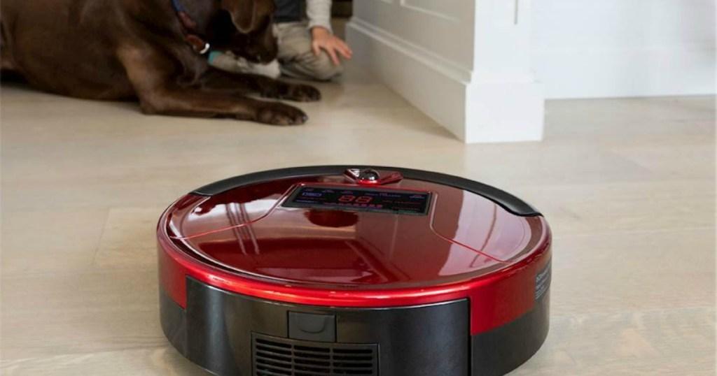 red robot vacuum on floor