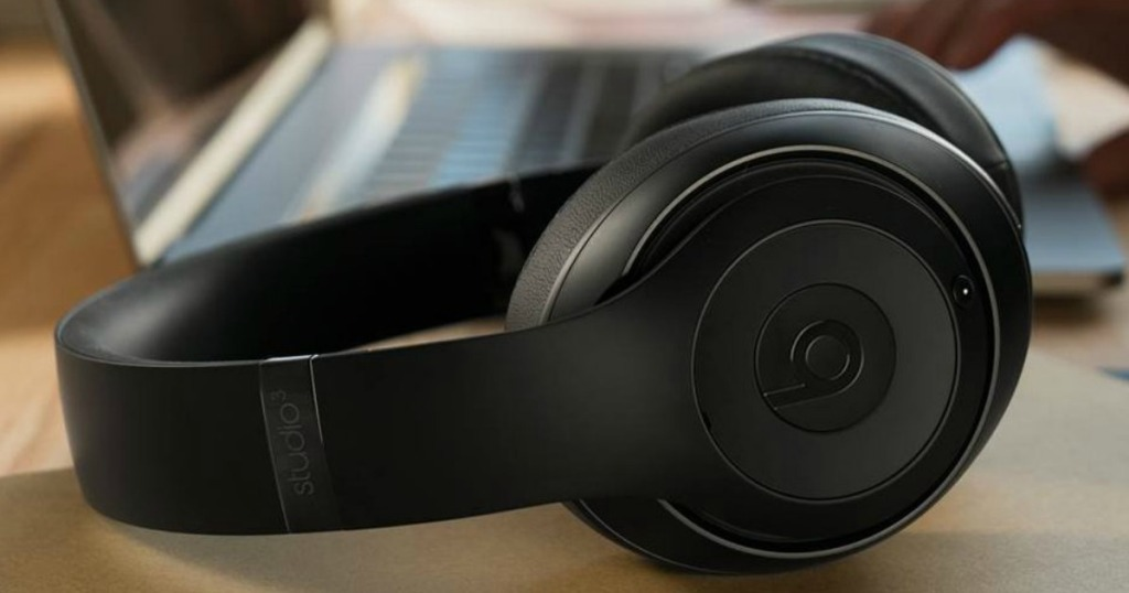 headphones sitting by a computer