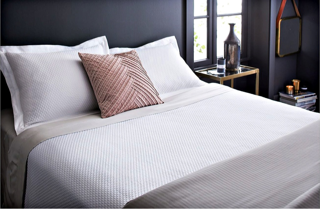 bed made up with Fieldcrest Diamond Matelasse Coverlet